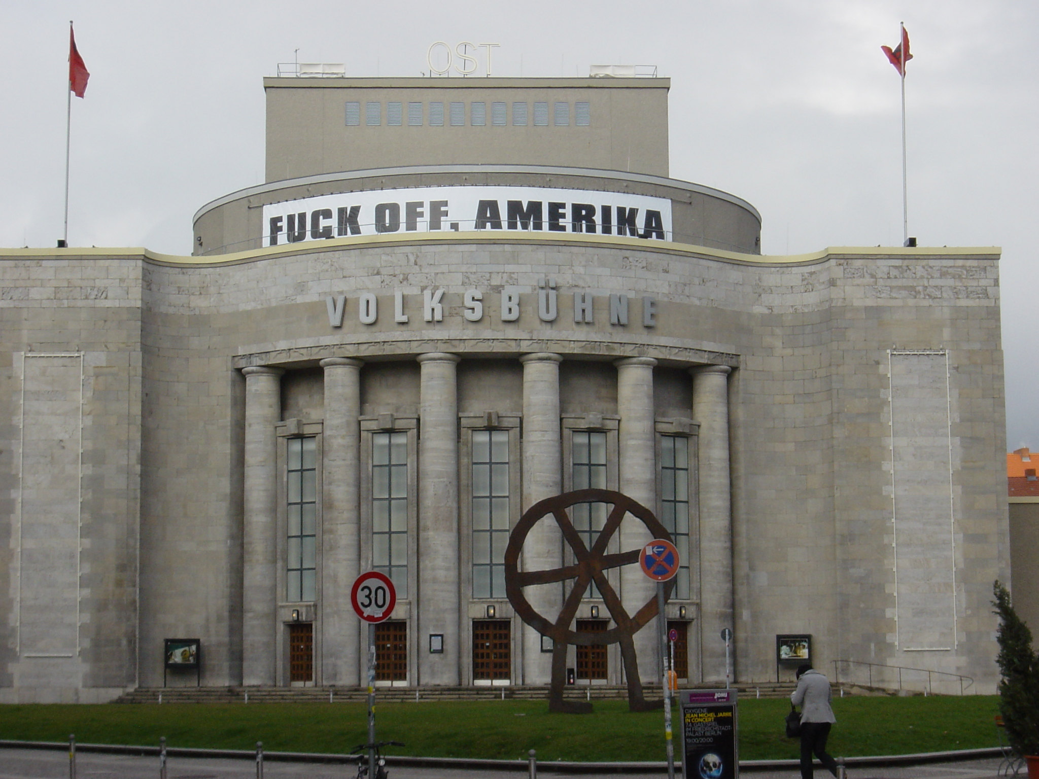 Volksbuehne, March 2008, a banner advertising the staging of Eduard Limonov's Fuck off, Amerika, The original uploader was Theearthshaker, CC BY-SA 3.0. Source: commons.wikimedia.org.